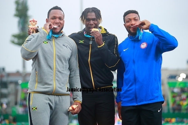 Lima, Tuesday, August 6, 2019 - Jamie Smikle from Jamaica, silver medal,  Andray Dacres from Jamaica, gold medal and Reginald Jagers from USA, bonze medal celebrate during Award Ceremony in Men's Discus Throw Final in Athletics at the Lima 2019 at Villa Deportiva Nacional - VIDENA during the Pan American Games Lima 2019. Copyright Héctor Vivas / Lima 2019  Mandatory credits: Lima 2019 ** NO SALES ** NO ARCHIVES **