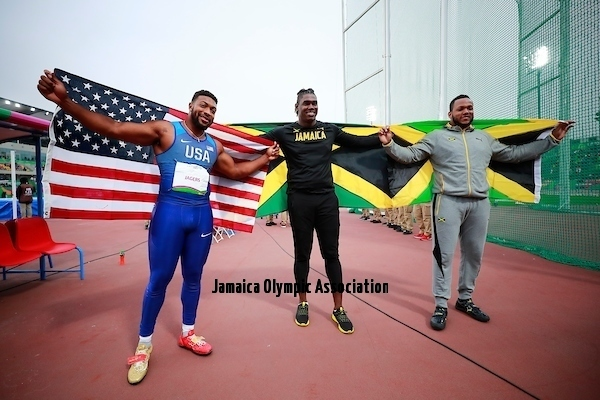 Lima, Tuesday, August 6, 2019 - Reginald Jagers from USA, bronze medal, Andray Dacres from Jamaica, gold medal and Jamie Smikle from Jamaica, silver medal,  celebrate after competition in Men's Discus Throw Final in Athletics at the Lima 2019 at Villa Deportiva Nacional - VIDENA during the Pan American Games Lima 2019. Copyright Héctor Vivas / Lima 2019  Mandatory credits: Lima 2019 ** NO SALES ** NO ARCHIVES **