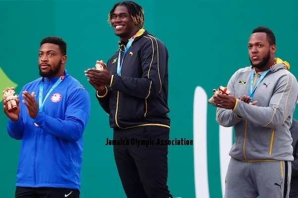 Lima, Tuesday, August 6, 2019 - Jamie Smikle from Jamaica, silver medal,  Andray Dacres from Jamaica, gold medal and Reginald Jagers from USA, bonze medal celebrate during Award Ceremony in Men's Discus Throw Final in Athletics at the Lima 2019 at Villa Deportiva Nacional - VIDENA during the Pan American Games Lima 2019. Copyright Marcos Brindicci / Lima 2019  Mandatory credits: Lima 2019 ** NO SALES ** NO ARCHIVES **